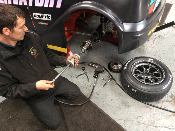 Servicing a wheel hub on a race car